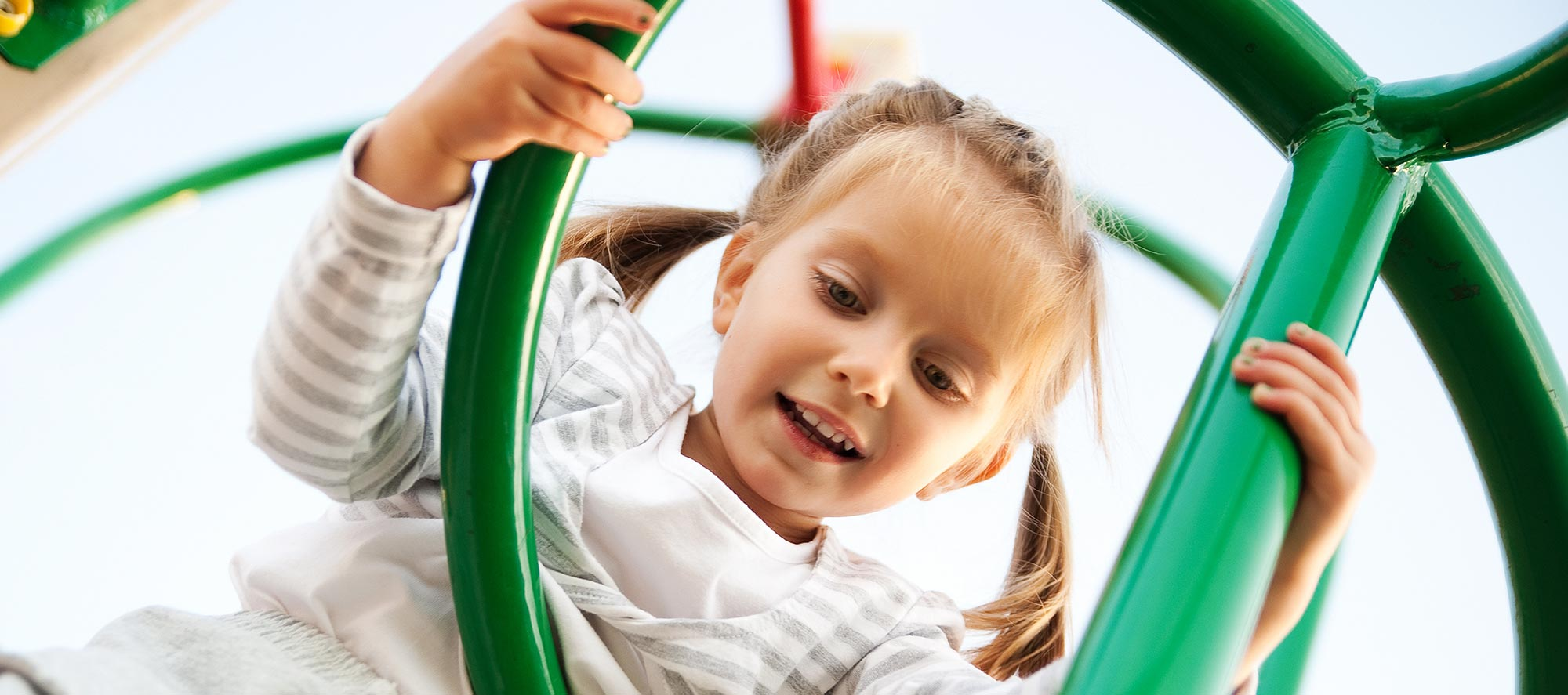 Girl on Playground - Pediatric Dentist in Madison, MS